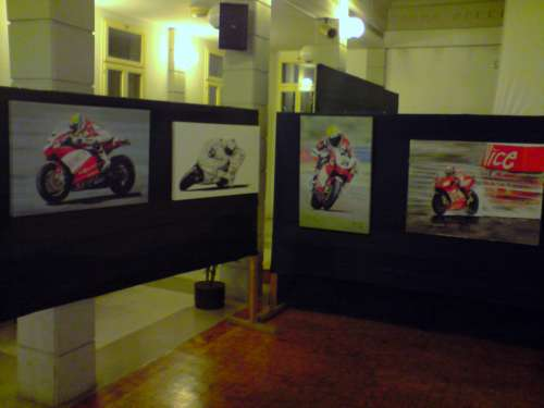 3 canvas prints and an original painting of Casey Stoner in the rain